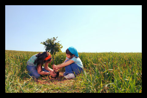 girls-planting-tree.jpg