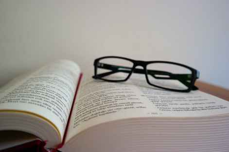 close up of eyeglasses on book
